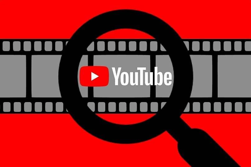 lupa enfocando logo youtube