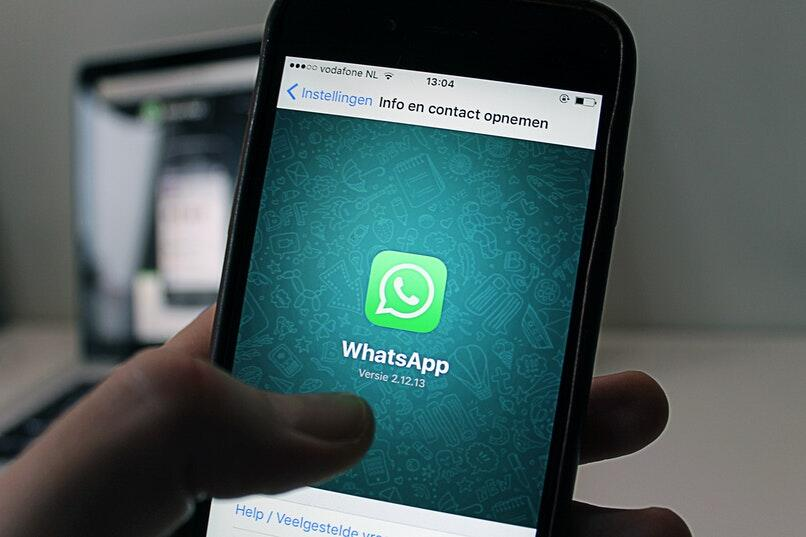 displays WhatsApp open on a mobile phone