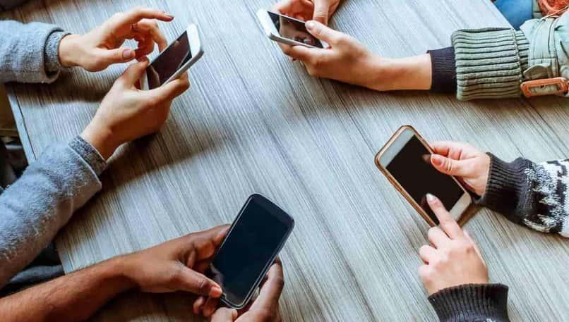 group of people using phones