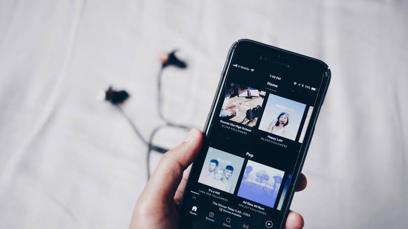 usa spotify escuchar musica dos dispositivos